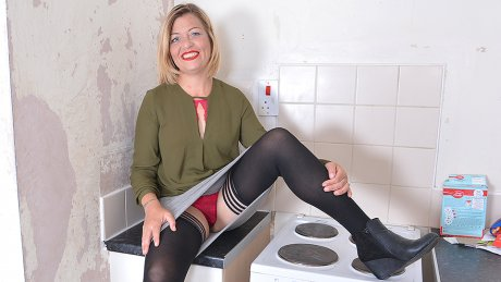 Naughty Housewife Playing With Her Wet Pussy On The Kitchen Counter