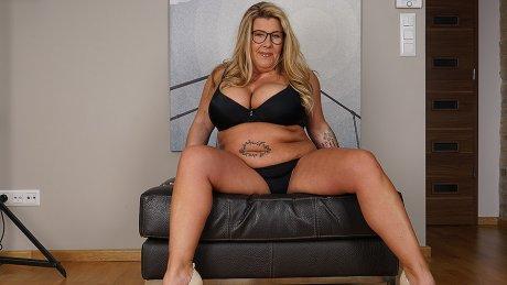 German Housewife Shows Off Big Tits And Masturbates