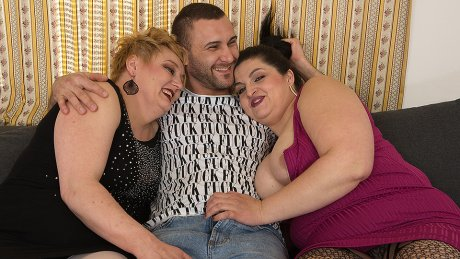Two dirty housewives share a big cock in this hot threesome