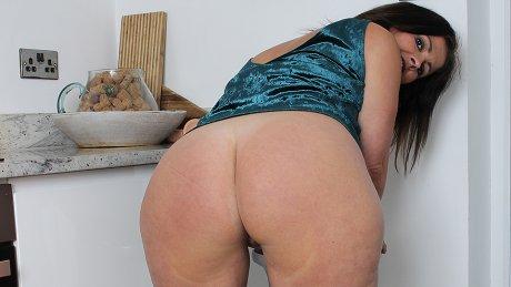 Spanish Milf with big ass fucks herself with a dildo