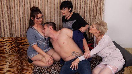 Three sexy mature ladies share the young cleaner's big cock