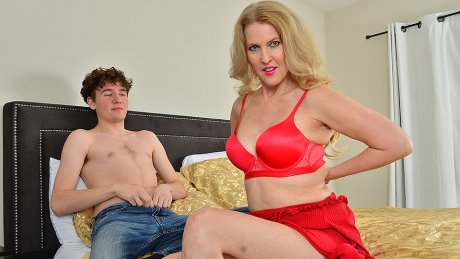 Blonde MILF Lacy B. Cummings enjoys the big cock of her son's best friend