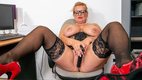 German Milf secretary shows great rack and masturbates