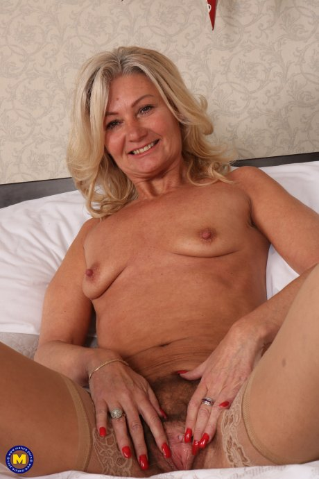 Hairy British housewife playing with her bushy pussy