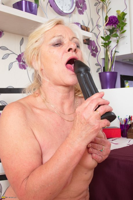 Horny mature lady getting ready to play with her toy