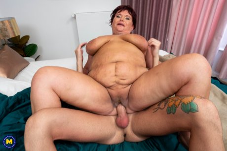 Naughty young man doing a big breasted mature slut