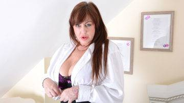 Big Breasted British Housewife Playing With Her Toy - presnted by Mature.nl